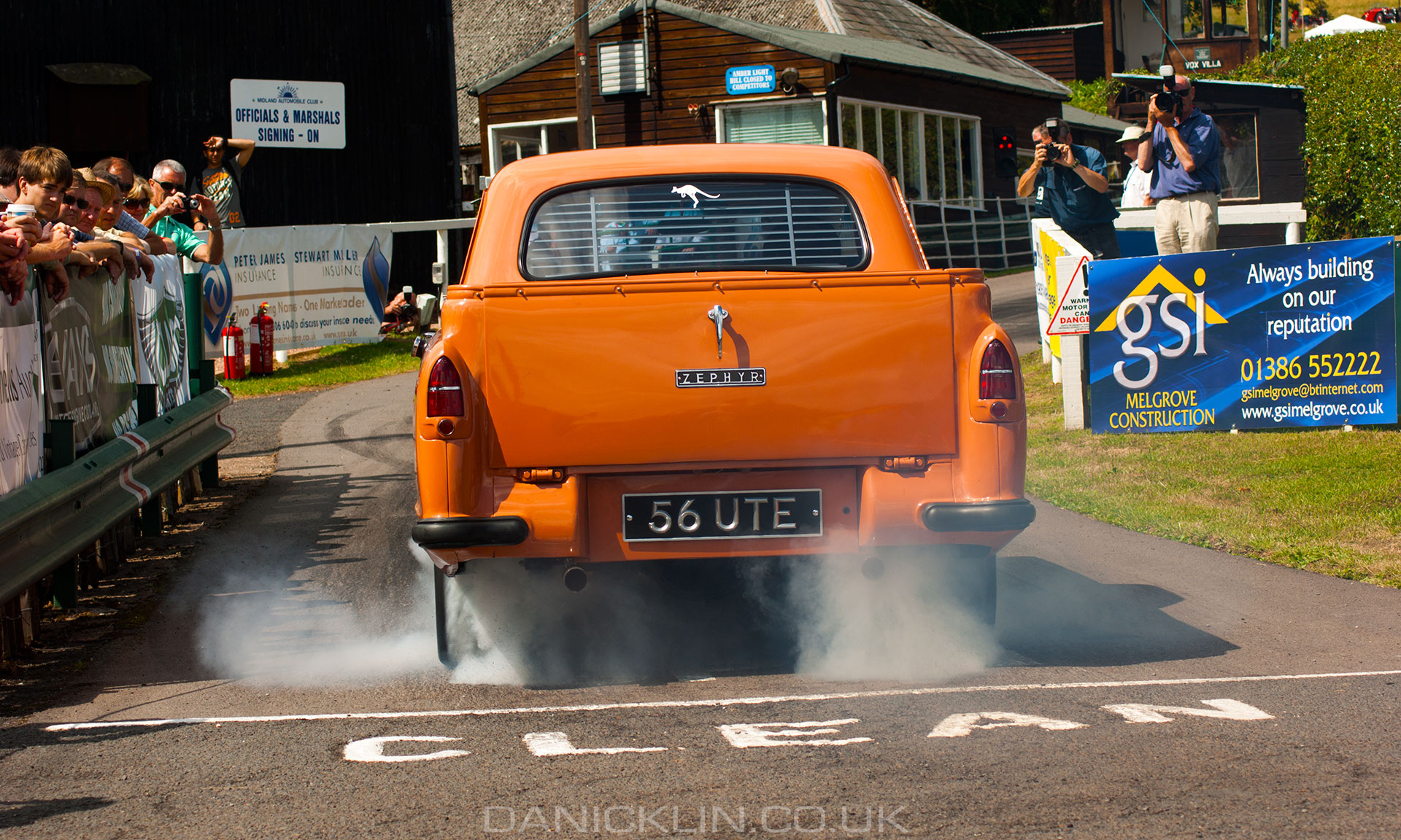 1956 Ford Zephyr Ute making an incredible amount of tire smoke on the start line